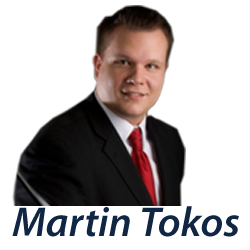 Martin Tokos - Coldwell Banker First Quality Realty Logo