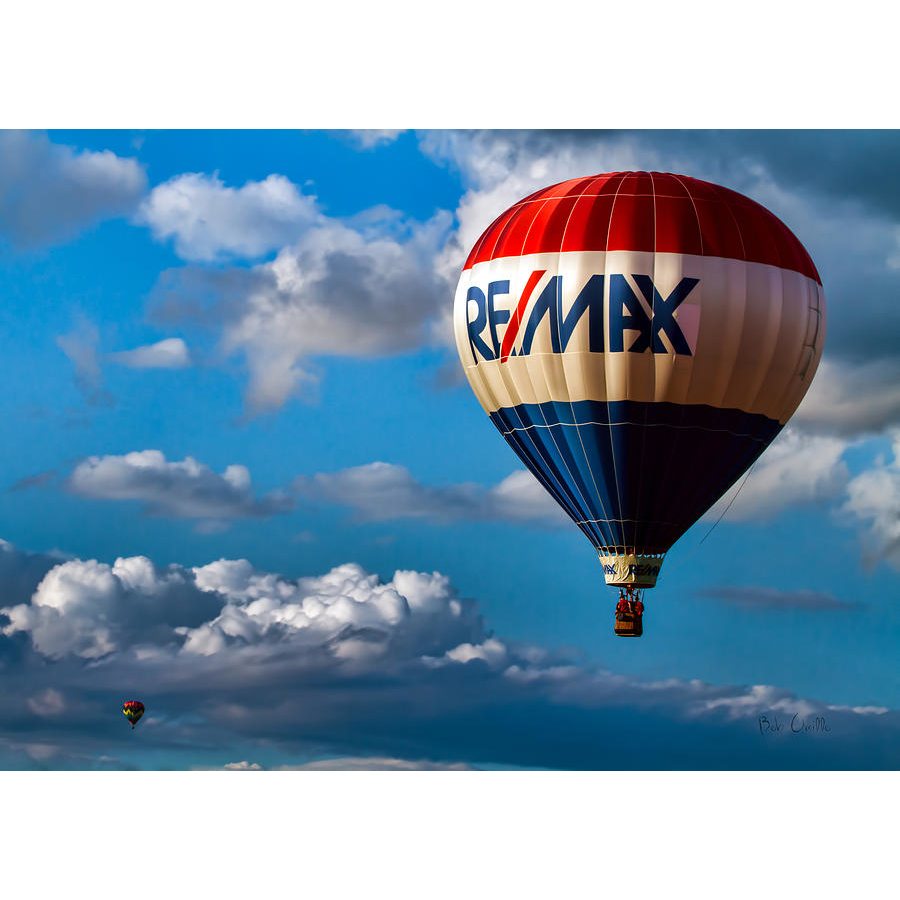 Donny Karcie - RE/MAX Mountain Properties Logo